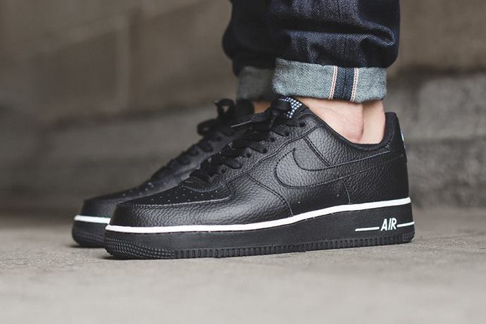 The iconic Nike Air Force 1 Low is rendered in a suede build
